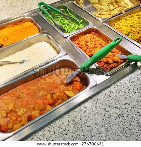 Catering buffet with a variety of vegetarian food in metal containers. - stock photo