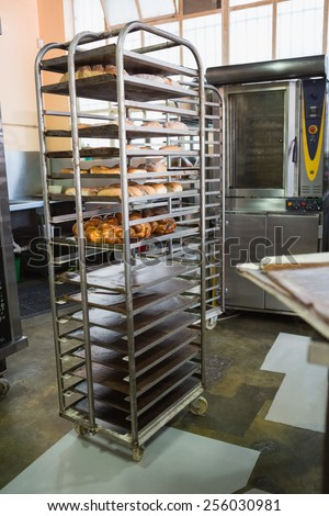 Catering building with shelf of fresh breads in the kitchen of the bakery