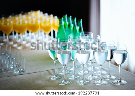 Catering drinks. Water, soda water, orange juice. Refreshment. Selective focus with bokeh background. - stock photo