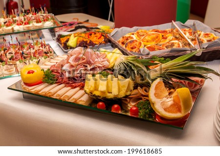 Catering food of vegetables, meat, seafood on a table served