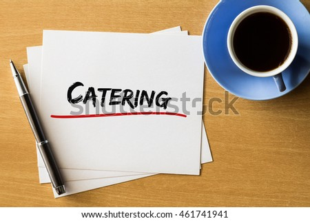 Catering - handwriting on papers with cup of coffee and pen, business concept
