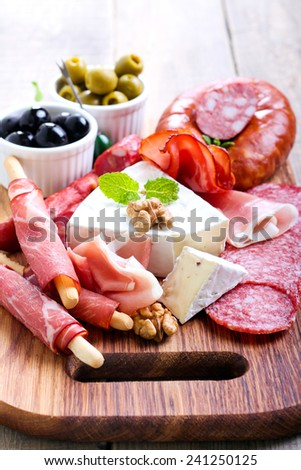 Catering platter with different meat and cheese - stock photo
