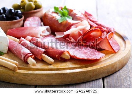 Catering platter with different meat and cheese products - stock photo