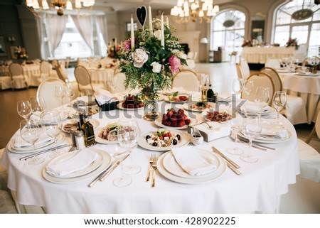 Catering service. Restaurant table with food.  Wedding celebration, decoration. Dinner time, lunch. - stock photo