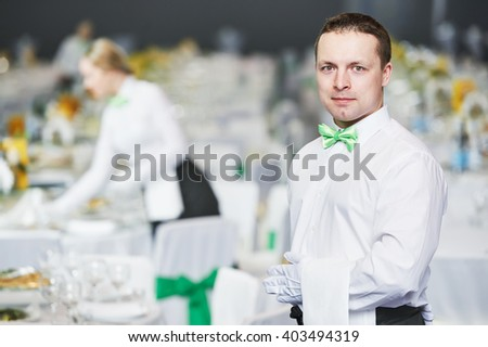 Catering service. waiter on duty in restaurant - stock photo