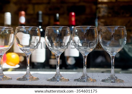 Catering service with glasses, fruits and wine buttles on bartender background
