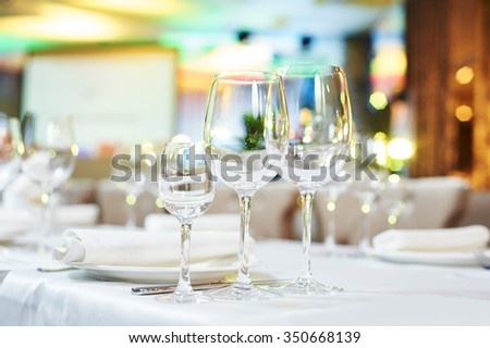 Catering services. glasses set and dishes plates in restaurant before event  - stock photo