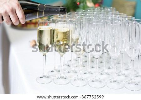 Catering services. Glasses with champagne in row. Background at restaurant party