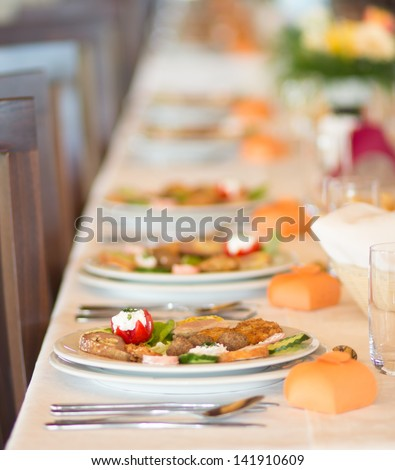 Catering table set service at restaurant before party - stock photo