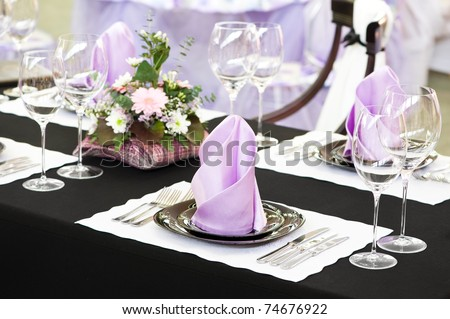 catering table set service with silverware, napkin and glassware at restaurant - stock photo