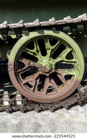 caterpillar rollers of tank close up - stock photo