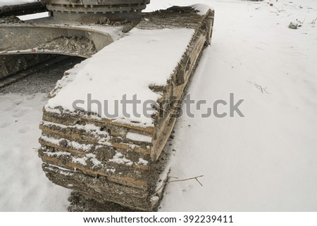 caterpillar wheel under snow winter