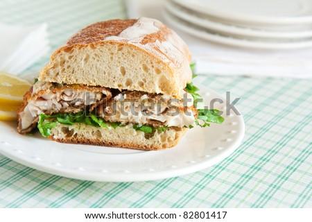 Catfish po' boy on crusty loaf - stock photo