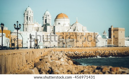 Cathedral and  embankment in  sunny  time. Cadiz, Spain - stock photo