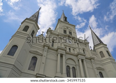 Cathedral and flowers - St Louis Cathedral, New Orleans, Louisiana - stock photo
