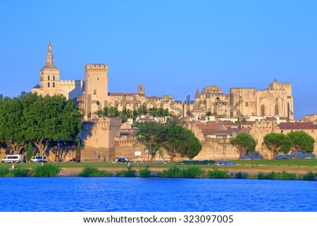 Cathedral and Papal Palace (Palais des Papes) across Rhine river at sunset, Avignon, Provence, France - stock photo