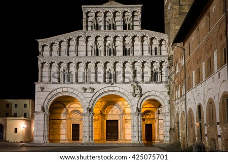 Cathedral at Night - Lucca Cathedral, or Duomo di San Martino in the Tuscan village of Lucca, Italy, photographed at night.  The medieval cathedral dates to the 13th century. - stock photo