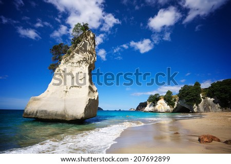 Cathedral Cove, Coromandel Peninsula, North Island, New Zealand. Empty beach on a sunny summer day.