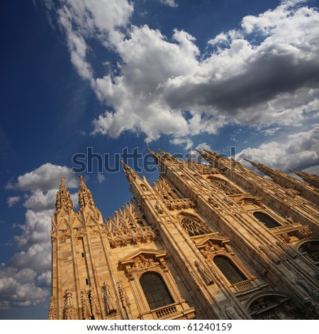 Cathedral Facade under a Cloudy Sky - stock photo
