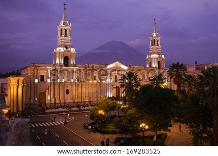 Cathedral of Arequipa in the evening with El Misti volcano - stock photo