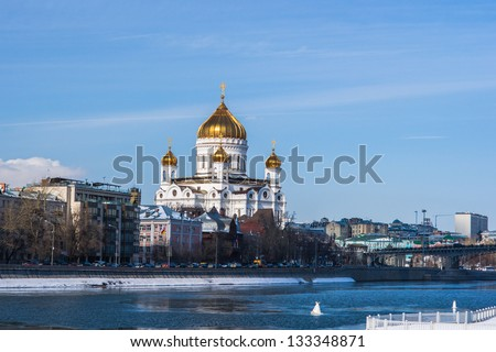 Cathedral of Christ the Savior and Moscow river in wintertime against the background of blue sky and white clouds - stock photo