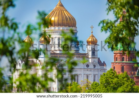 Cathedral of Christ the Savior with trees leaves - stock photo
