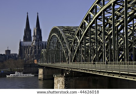 Cathedral of Cologne with iron arcs of Hohenzollern bridge, Cologne, Germany - stock photo