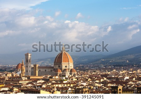 Cathedral of Florence, or the Cathedral of Santa Maria del Fiore, seen in morning light and surrounded by various Florentine buildings.  Copy space in sky if needed.