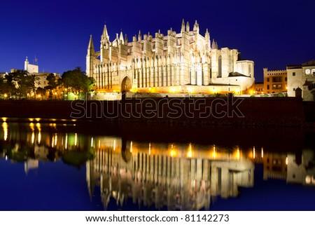 Cathedral of la Seu Majorca in Palma de Mallorca reflection over lake at Balearic islands - stock photo