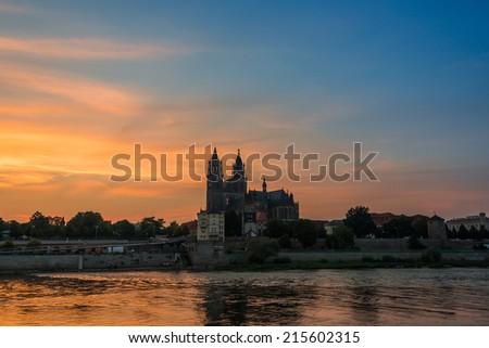 Cathedral of Magdeburg at the river Elbe at sundown, Magdeburg, Germany, 2014 - stock photo
