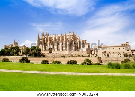 Cathedral of Majorca La seu view from grass garden under blue sky - stock photo