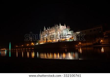 Cathedral of Palma de Mallorca La Seu night view and lake mirrored reflection of night illumination. Mallorca island, Spain. - stock photo