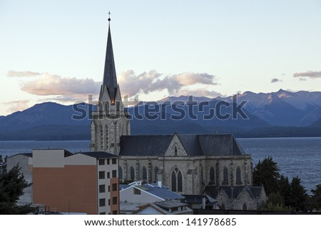 Cathedral of San Carlos de Bariloche - and the sunset over Nahuel Huapi Lake. - stock photo