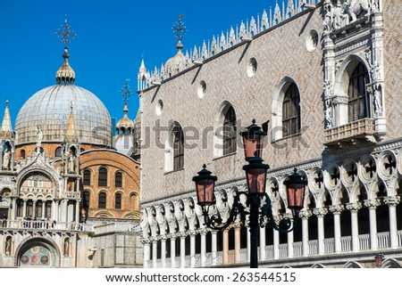 Cathedral of San Marco (San Marco basilica) in Venice, Italy with seagull flying above in the sky. View from San Marco square. Architecture postcard background. - stock photo