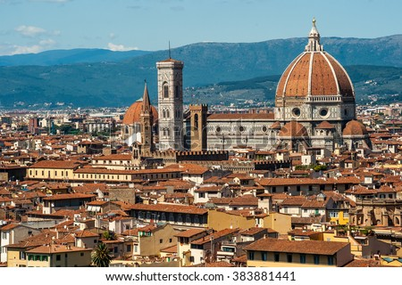 Cathedral of Santa Maria del Fiore in Florence, Italy. Beautiful cityscape image with red roofs of renaissance and medieval architecture. - stock photo