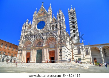 Cathedral of Siena in sunny square, Tuscany, Italy