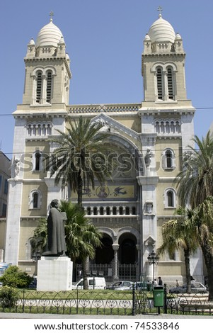 Cathedral of St. Vincent de Paul in Tunisia and statue of Ibn Khaldoun - stock photo