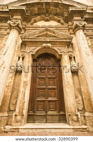 Cathedral old wooden door in tuscany