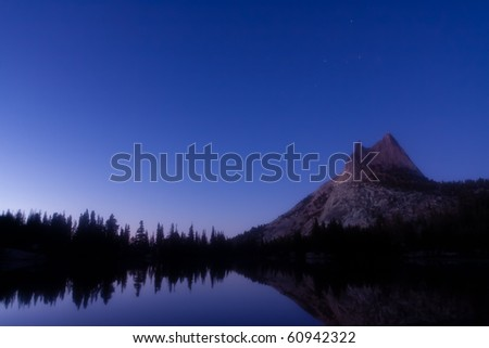 Cathedral Peak and Cassiopeia at Twilight. Taken at Upper Cathedral Lake in Yosemite National Park - stock photo