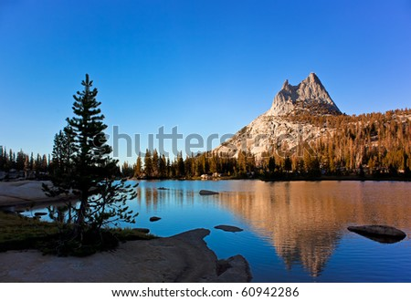 Cathedral Peak is Reflected in the Cool Blue waters of Cathedral Lake - stock photo