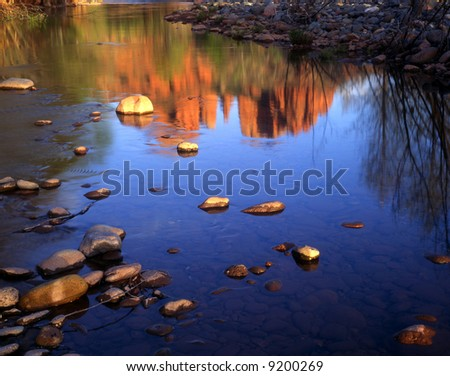 Cathedral Rock in the Coconino National Forest, Arizona, reflecting in Oak Creek. - stock photo
