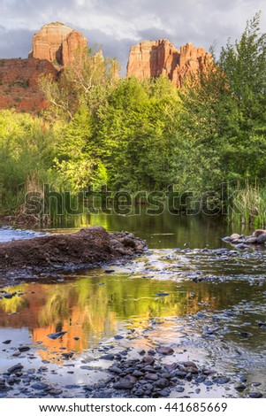 Cathedral Rock is reflected in Oak Creek in Red Rock Cross-Crescent Moon Park in Sedona, Arizona - stock photo