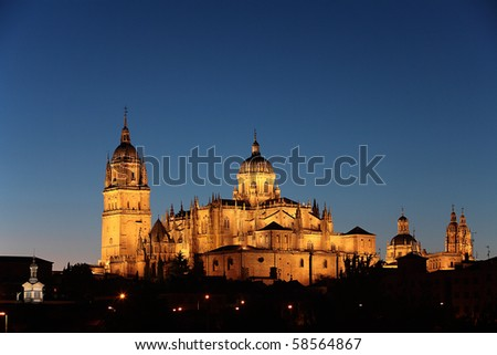 Cathedral under dark Blue Sky at Night - Salamanca, Spain - stock photo