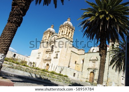 Cathedral with palms in Oaxaca city in Mexico - stock photo
