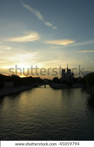 Cathedrale De Notre Dame De Paris at sunset. - stock photo