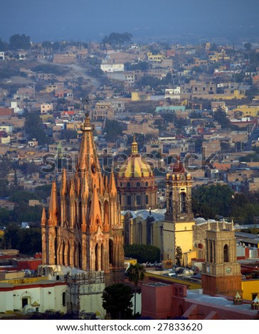 Cathedrals at the center of San Miguel Arcangel, San Miguel de Allende, Mexico.  Seen here: La Parroquia (Church of St. Michael the Archangel) and the Temple of the Nuns - stock photo