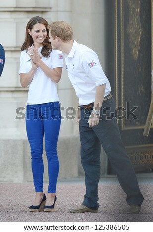 Catherine, Duchess of Cambridge and Prince Harry welcome the olympic torch to Buckingham Palace, London, UK. July 26, 2012. - stock photo