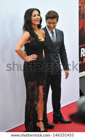 """Catherine Zeta-Jones & Byung Hun Lee at the Los Angeles premiere of their new movie """"Red 2"""" at the Westwood Village Theatre. July 11, 2013  Los Angeles, CA - stock photo"""