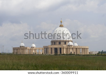 "Catholic Basilica of Our Lady of Peace (Basilique Notre-Dame de la Paix) in Yamoussoukro, Cote d'Ivoire. Guinness World Records lists it as the largest ""church"" in the world. - stock photo"