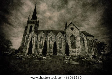 Catholic church and cemetery - stock photo